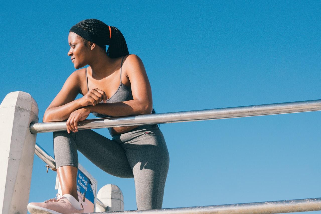woman taking a break from her jog