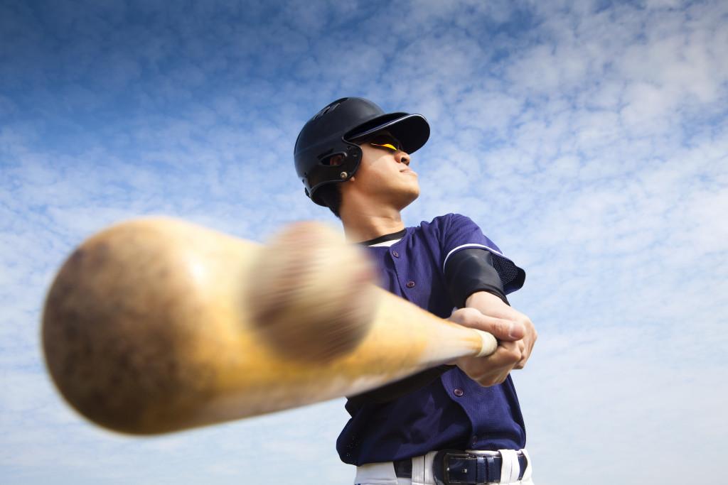 person hitting a baseball